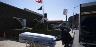 Worker bringing coffin to funeral home