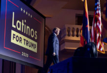 Donald Trump with Latinos for Trump sign