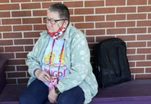 A woman waits outside a senior center