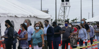 People wait in line for vaccine