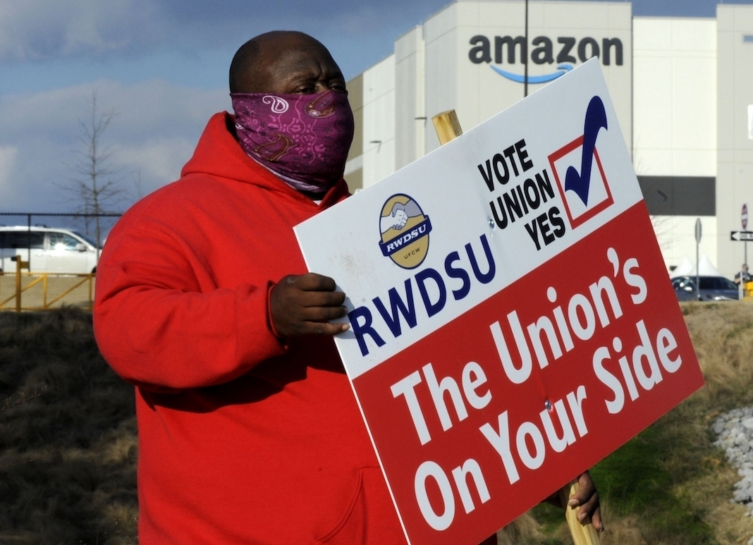 Union organizer with sign
