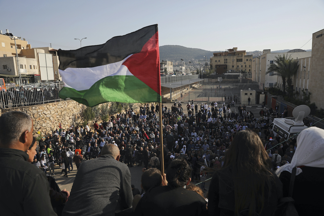 Palestinian flag flying over Land Day rally in Israel