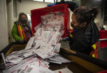 Election worker with ballots