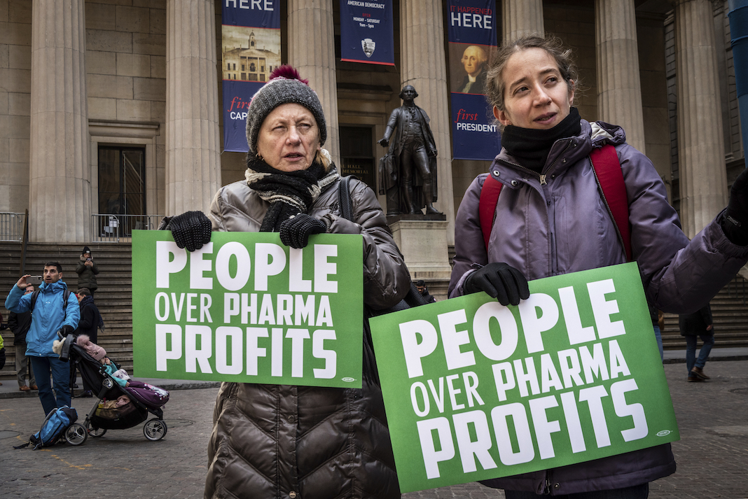 Advocates rally outside the New York Stock Exchange.