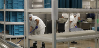 Immigrants working at detention center