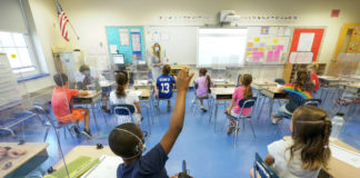 Kids socially distanced in a classroom, May 2021