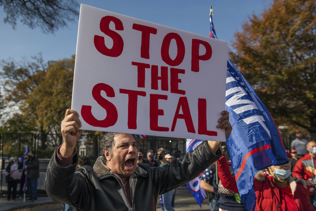 Yelling man with Stop the Steal sign