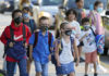 Students wear protective masks