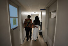 Abortion clinic worker escorts patient